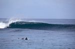 Douggs and Brett sharing a moment while perfect lefts pass them by Mentawai Islands, West Sumatra - Photo Aki