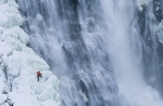 Neil Gresham on the half frozen waterfall of Montmorency falls in Quebec