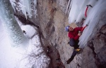 Neil Gresham swinging onto the fragile icicle of Amphibian a climb in Vail Colorado USA