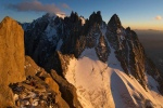 Jeff and Frederic Souchon look for a bivy spot whilst the sun sets on the Blatiere and Mont Blanc in the distance
